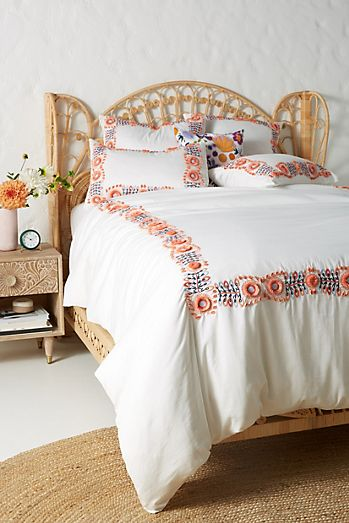 https://www.anthropologie.com/shop/embroidered-petunia-duvet-cover?category=sale-home&color=095